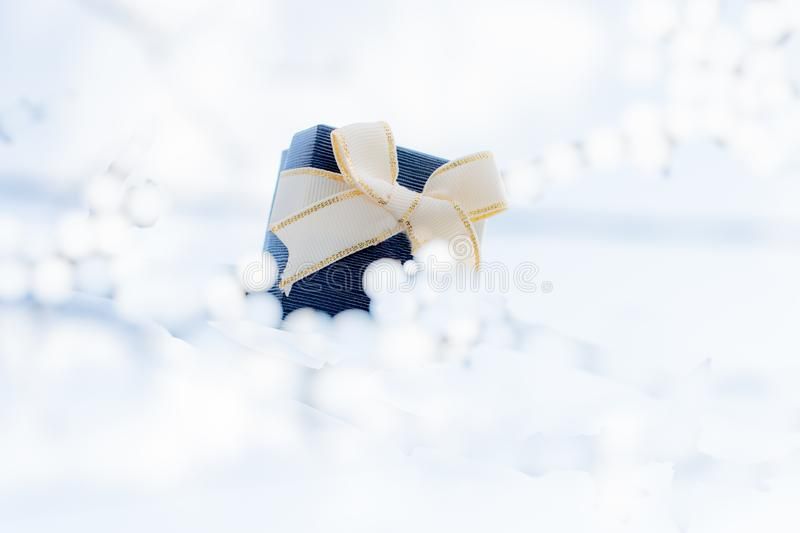 Gift box with bow for gifts on Christmas, birthday or Valentines royalty free stock photos