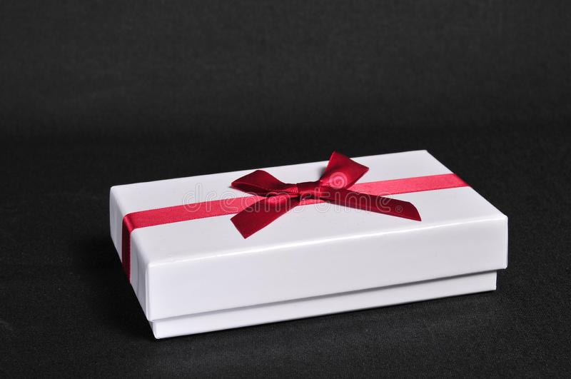 Gift box with bow for gifts on Christmas, birthday or Valentines stock photos
