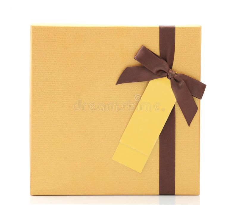 Gift box with bow ribbon and Greeting card label. Gold yellow gift box with bow ribbon and Greeting card label on white background stock images