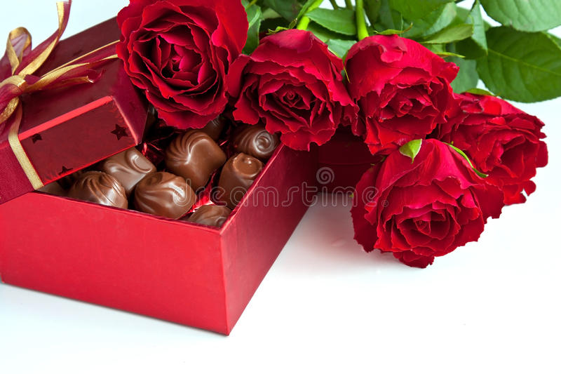 Gift Box Of Chocolate Truffles With Red Roses Stock Photo