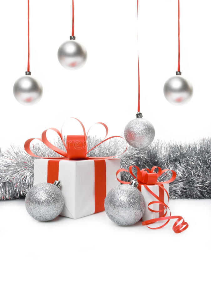 Gift box and Christmas baubles stock images