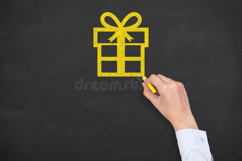 Gift Box Christmas on Chalkboard Background royalty free stock images
