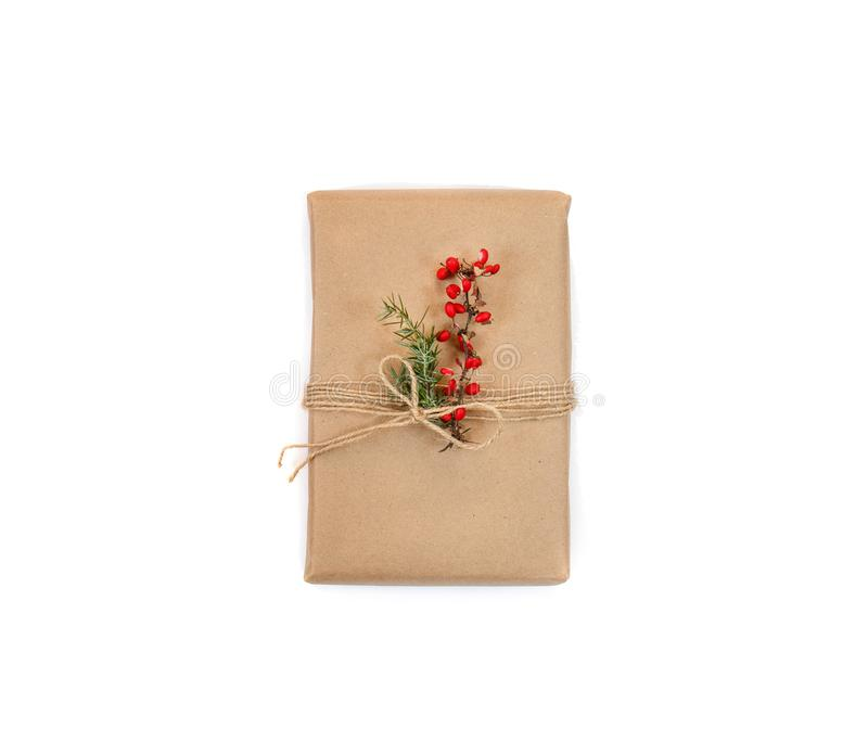 Gift box for Christmas and New Year from craft paper  white background. Handmade decor with natural plants stock photos