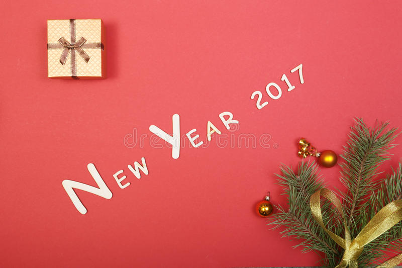 Gift box with christmas tree on red background.  stock images
