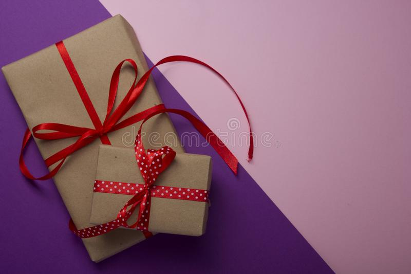 Gift box on color background. Top view. Copy space for text. Flat lay royalty free stock image