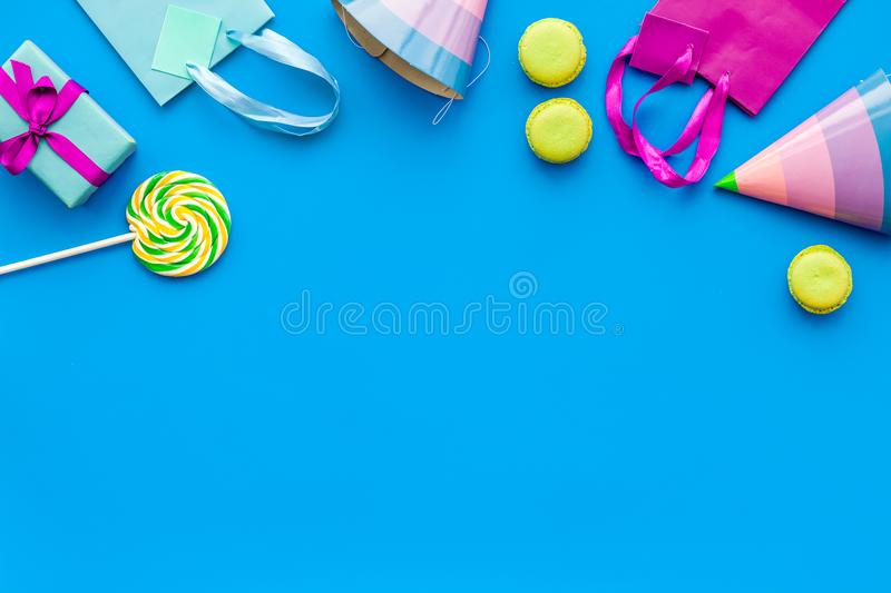 Gift box and colorful paper bag on blue background top view mock-up royalty free stock images