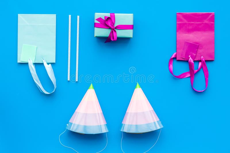 Gift box and colorful paper bag on blue background top view mock-up royalty free stock photography