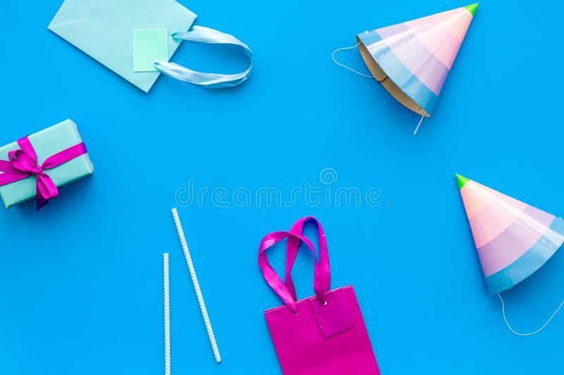Gift box and colorful paper bag on blue background top view mock-up stock photos
