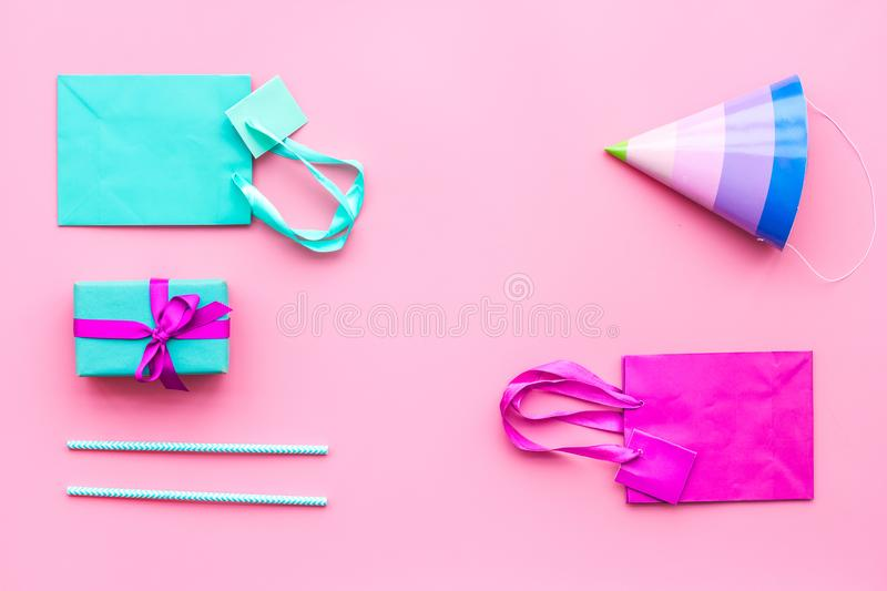 Gift box and colorful paper bag on pink background top view mock-up royalty free stock images