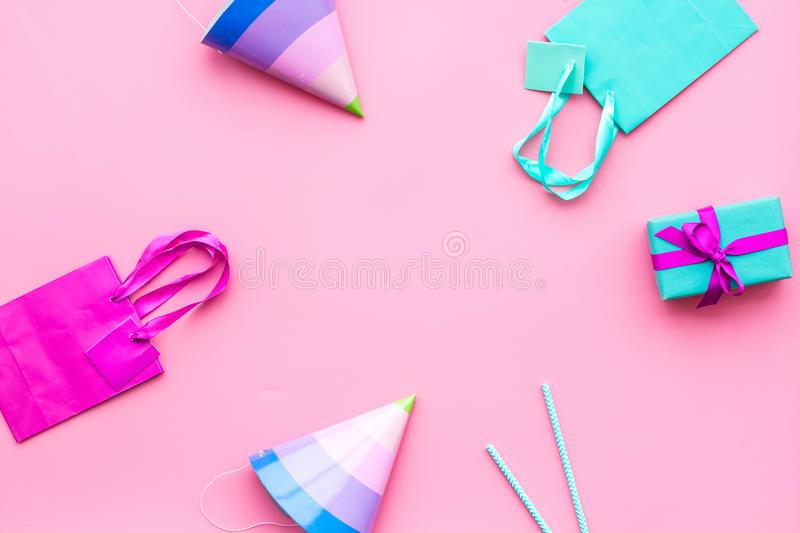Gift box and colorful paper bag on pink background top view mock-up royalty free stock photos