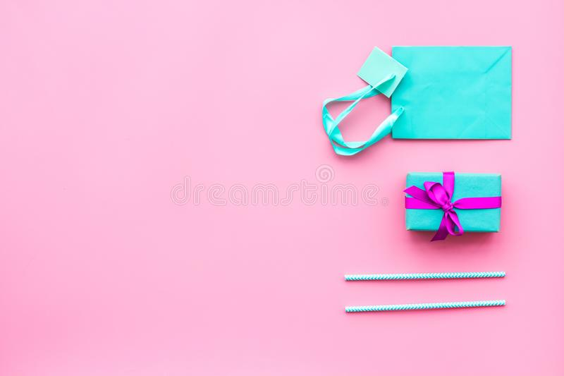 Gift box and colorful paper bag on pink background top view mock-up stock photo