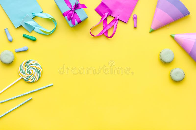 Gift box and colorful paper bag on yellow background top view space for text stock photos