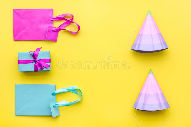 Gift box and colorful paper bag on yellow background top view space for text royalty free stock image