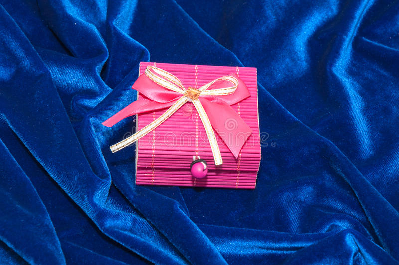 Gift in a box. Decorated with colorful ribbons royalty free stock image