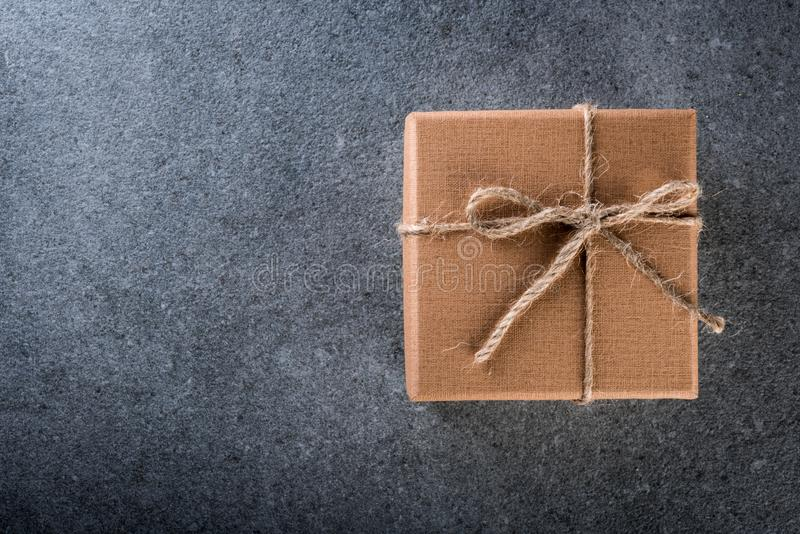 Gift box with empty space for text, a blank card and mockup, presents for Christmas , desktop top view.  royalty free stock photo