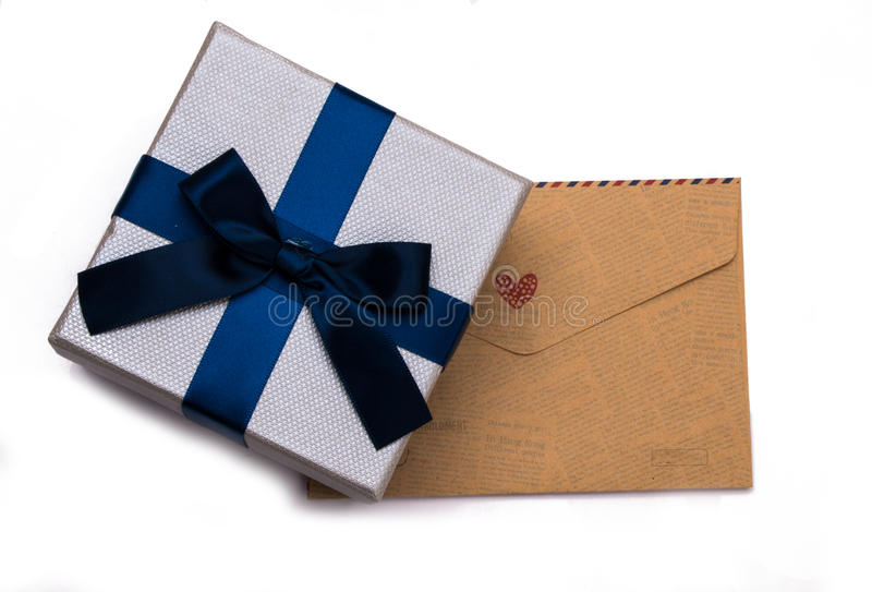 Gift box and envelope. On white background royalty free stock photo