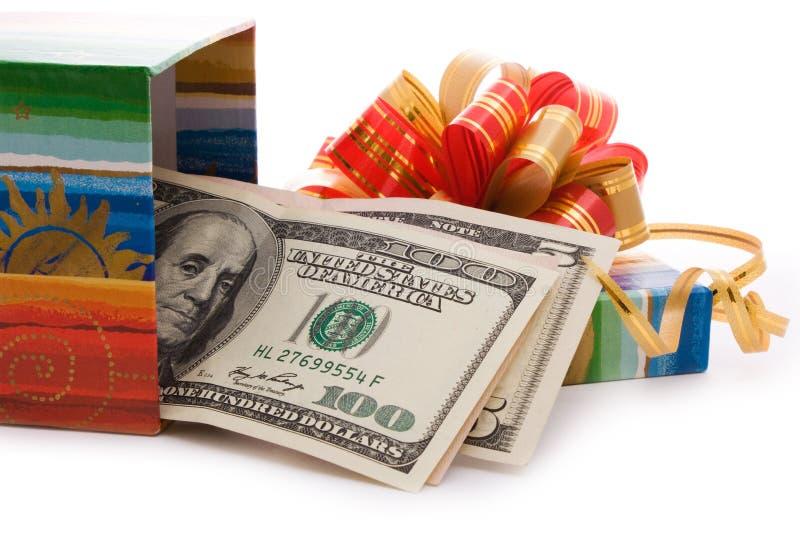 Gift box full of dollar bills