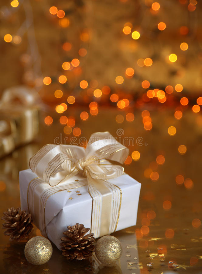 Gift box on golden background stock images