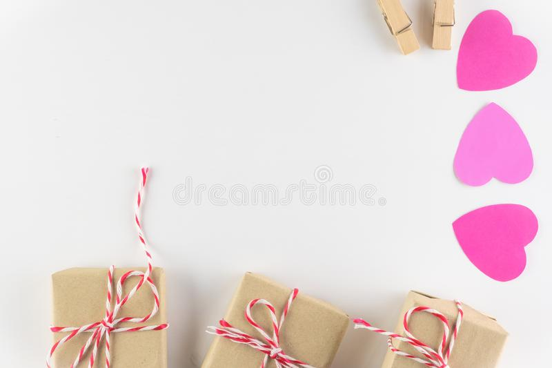 Gift box and Hand-made pink love hearts isolated on white wooden background, Happy valentine`s day. holiday background. Flat lay, top view, copy space royalty free stock images