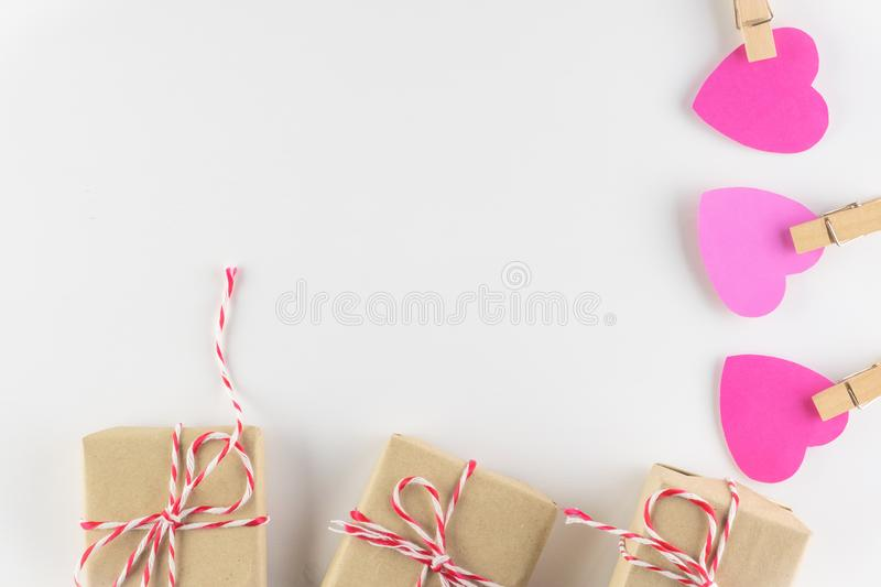Gift box and Hand-made pink love hearts isolated on white wooden background, Happy valentine`s day. holiday background. Flat lay, top view, copy space stock photography