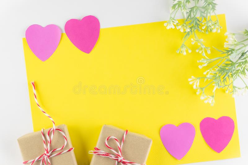 Gift box and Hand-made pink love hearts isolated on yellow texture background, Happy valentine`s day. Holiday background, Flat lay, top view, copy space royalty free stock photo