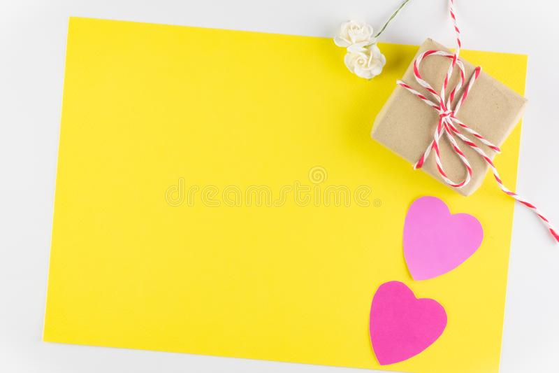 Gift box and Hand-made pink love hearts isolated on yellow texture background, Happy valentine`s day. Holiday background, Flat lay, top view, copy space royalty free stock photography