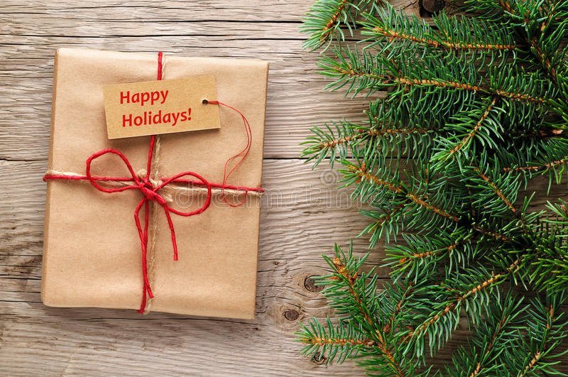 Gift box with happy holidays text on tag stock photo