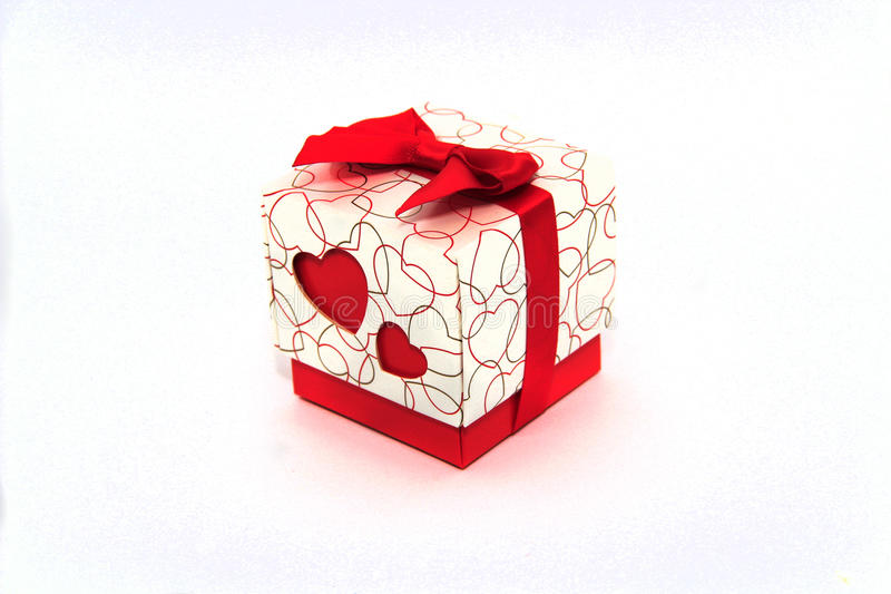 Gift in a box with a heart for March 8 stock photography