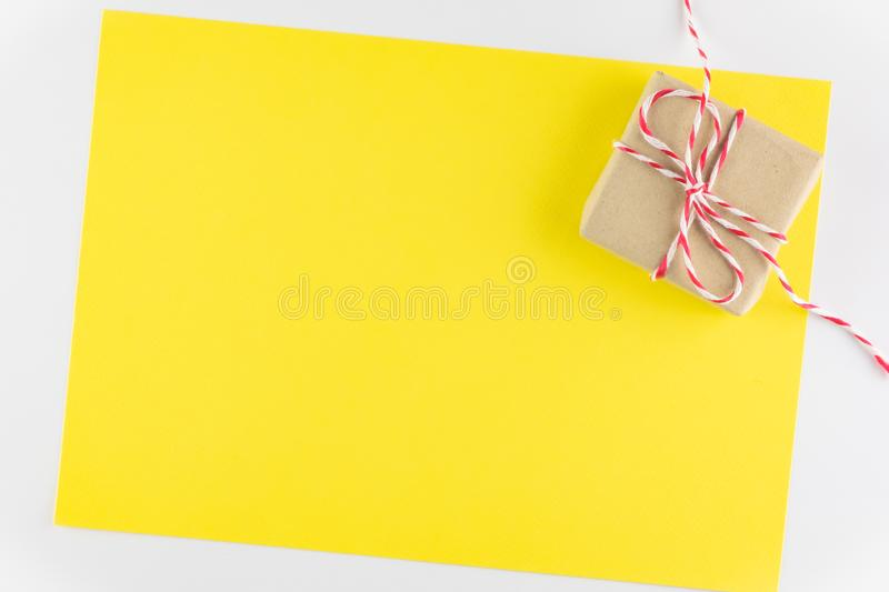 Gift box isolated on yellow texture background, Happy valentine`s day. Holiday background, Flat lay, top view, copy space stock photos