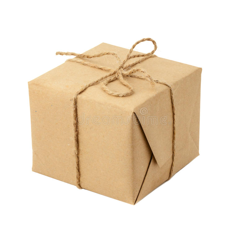 Gift box or mail parcel, wrapped with craft paper and twine isolated stock image
