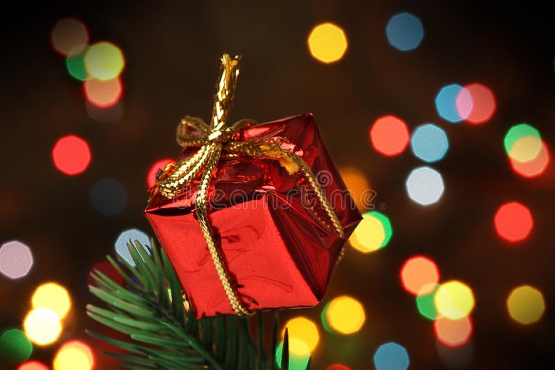 Download Gift Box Over A Christmas Branch Tree Stock Image - Image: 6611191