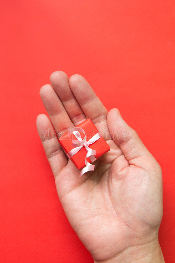 Download Gift box in palm stock photo. Image of hand, receive - 26696304