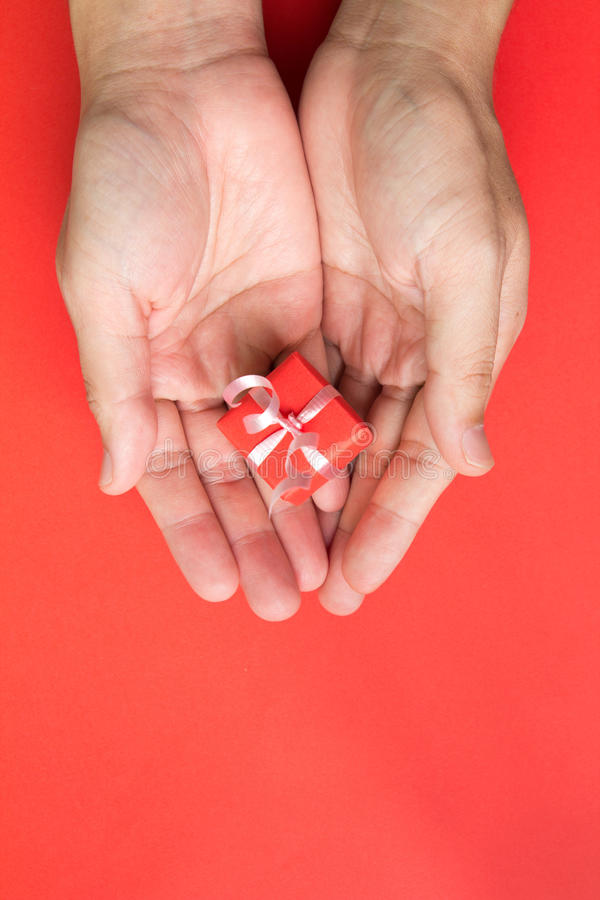 Download Gift box in palm stock photo. Image of santa, pack, give - 26696306