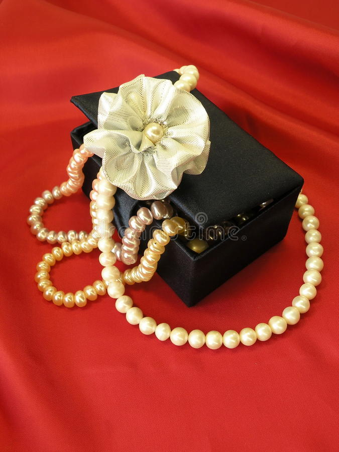 Gift box with pearls royalty free stock photography