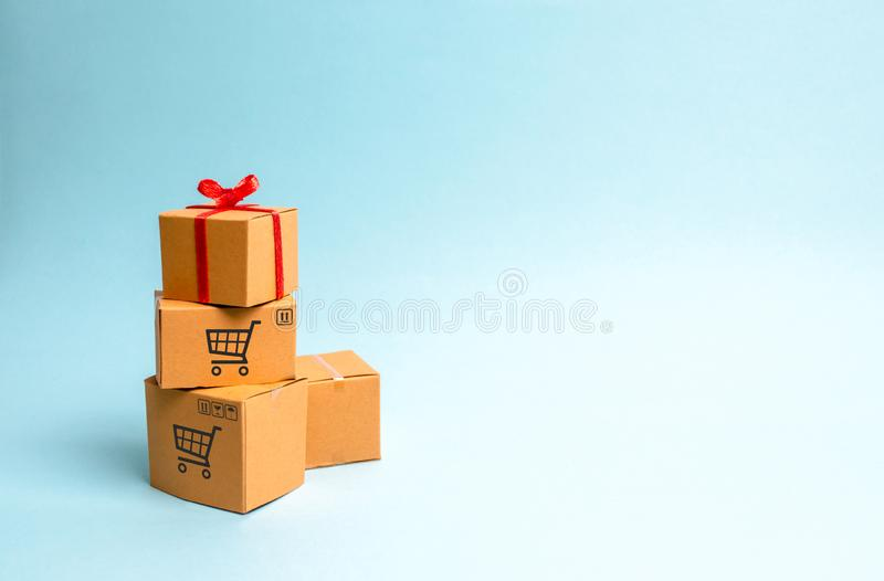 A gift box on a pile of boxes. The concept of finding the perfect gift. Limited offer Buy a gift on time. Sale, big discounts royalty free stock photography
