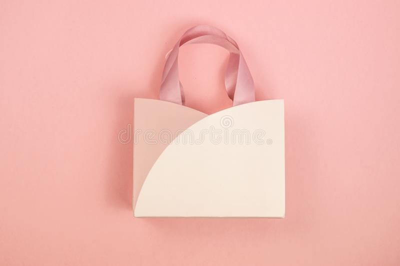 Gift box on pink background. February 14 card, Valentine`s day. 8 March, International Happy Women`s Day. stock photo