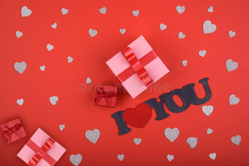 Gift box. pink box on red background with inscription i love youred and silver hearts. Valentines day, mothers day, holiday stock images