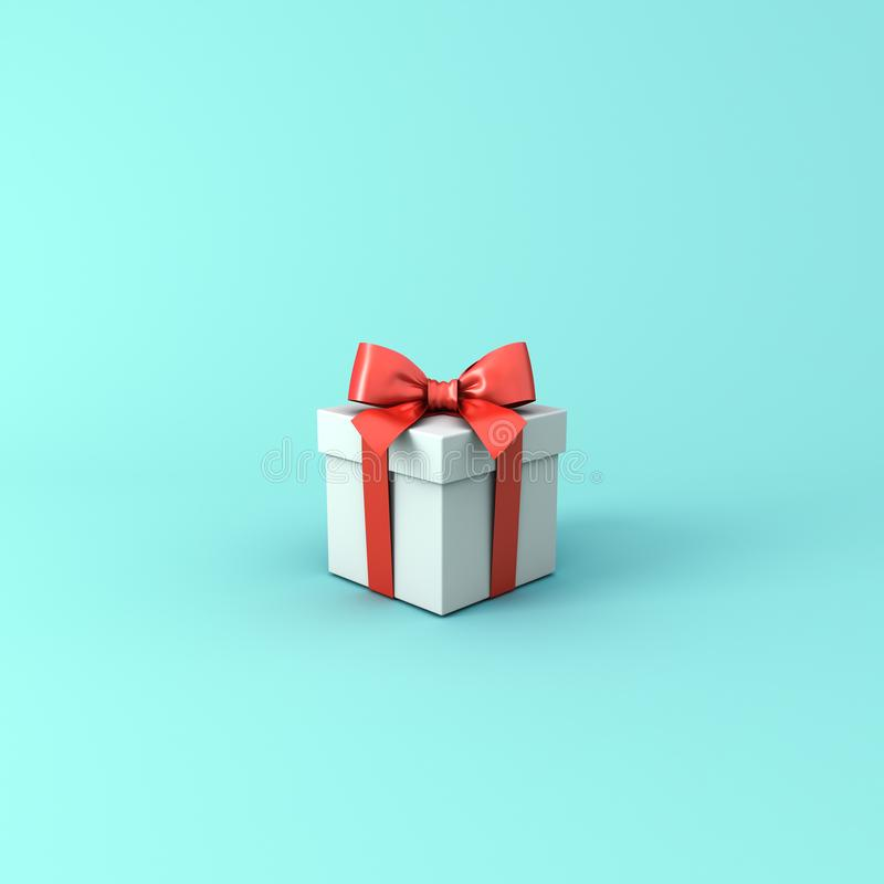 Gift box or Present box with red ribbon and bow isolated on light blue green pastel color background stock photos