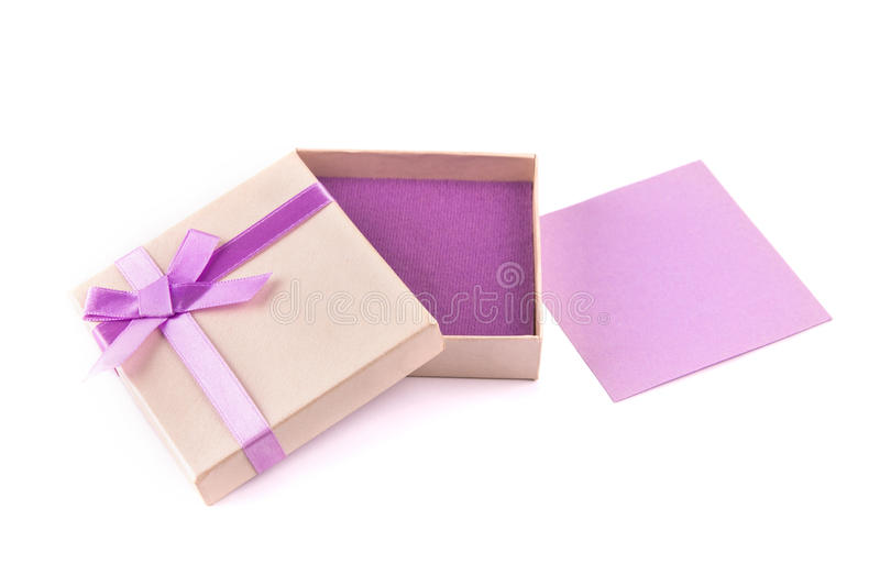 Gift box with purple ribbon bow, isolated on white royalty free stock image