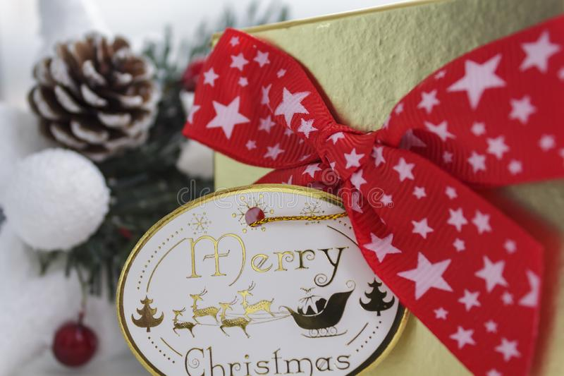 Gift box with red bow and merry christmas card.  royalty free stock photo