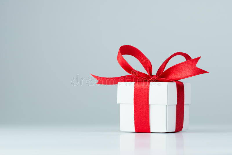 Gift box. With red ribbon on white background stock photos