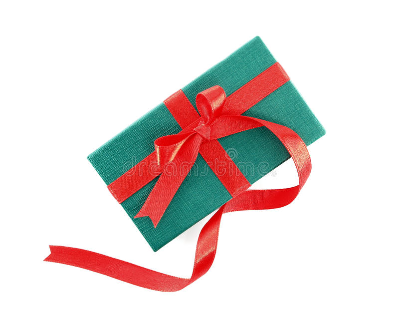 small green gift box with long red ribbon bow isolated on white background royalty free stock images