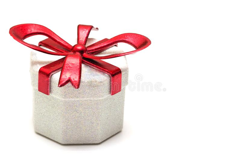 Gift box with a red ribbon on a white background stock photo