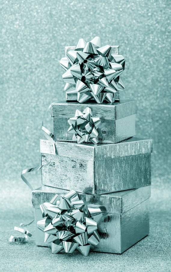 Gift box with ribbon decoration on silver background stock image