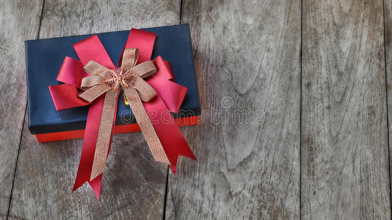 Gift box with ribbon on wooden background. Celebration concept royalty free stock photo