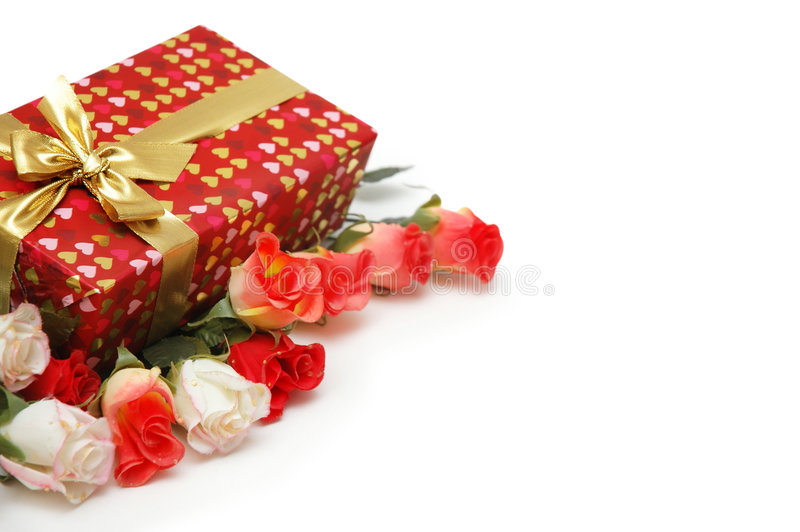 Gift box and roses isolated royalty free stock photos