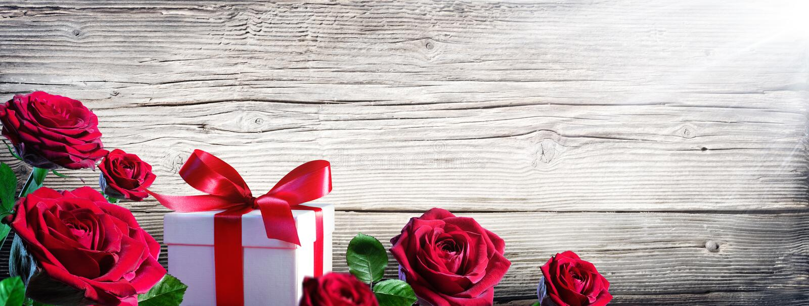 Gift Box And Roses royalty free stock image