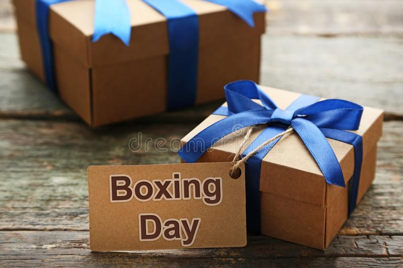 Gift box with sale tag. And inscription Boxing Day Sale royalty free stock photos