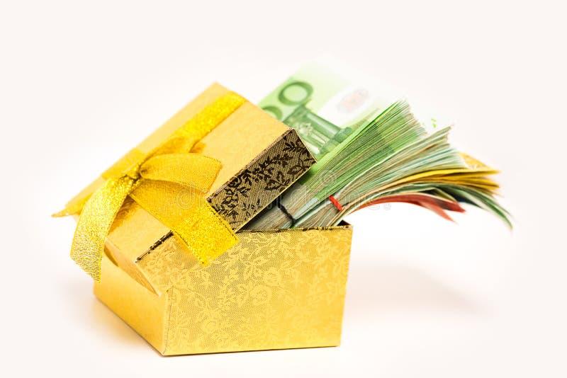 Gift box for savings full of euro banknotes money cash. Financial success debt free concept. stock photos