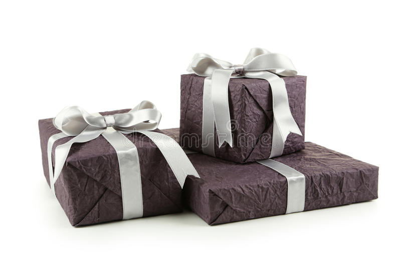 Gift box with silver bow isolated on white background stock photography